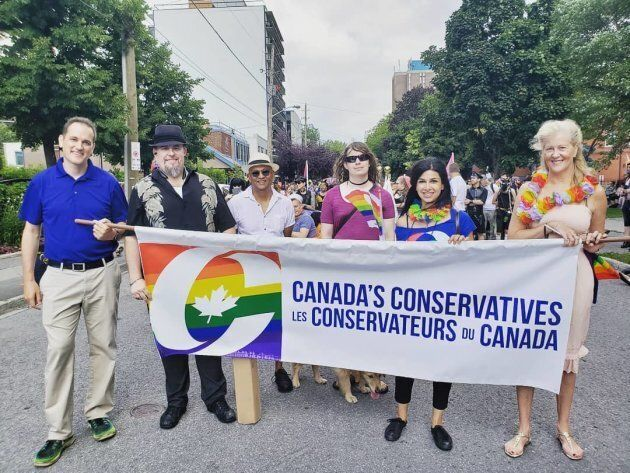 Ontario MPP Goldie Ghamari marches in a Pride parade with a banner representing the Conservative Party...