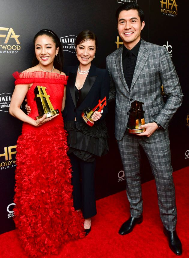 "From left to right: Constance Wu, Michelle Yeoh, and Henry Golding, recipients of the Hollywood Breakout Ensemble Award for ""Crazy Rich Asians."""