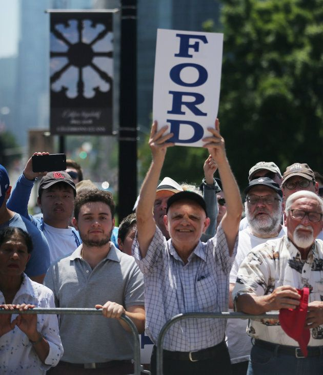 Supporters watch as Doug Ford performs a ceremonial swearing in at Queen's Park in Toronto on June 29,