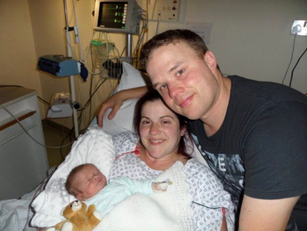 Rob Crussell, with his wife Kate, and son Theo. Theo died shortly after he was born.