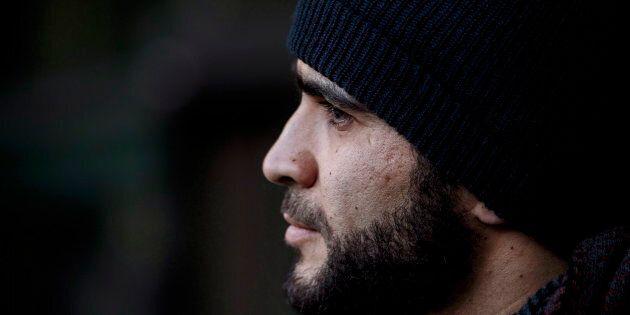 Omar Khadr speaks outside court in Edmonton on December 13,