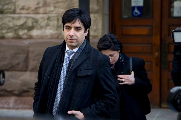 Jian Ghomeshi walks in front of his lawyer Marie Henein outside of a Toronto courthouse in March, 2016.
