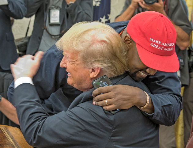 American rapper and producer Kanye West embraces U.S. President Donald Trump in the White House's Oval Office in October 2018.