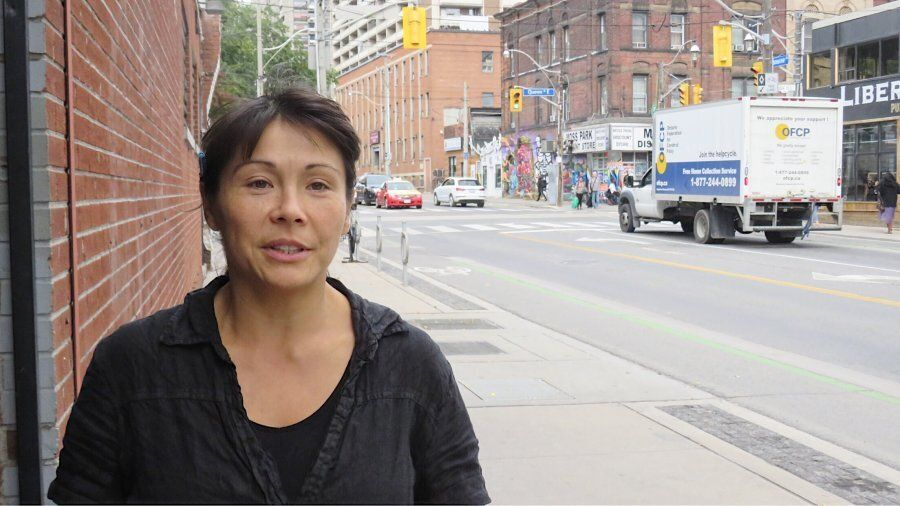 Jen Ko, a site co-ordinator, is skeptical of encroaching development in the Moss Park