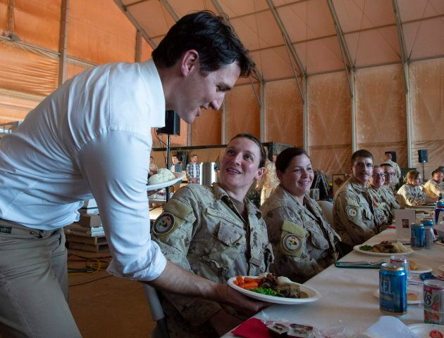 Prime Minister Justin Trudeau serves turkey dinner to members of the Canadian Armed Forces in Gao, Mali,...