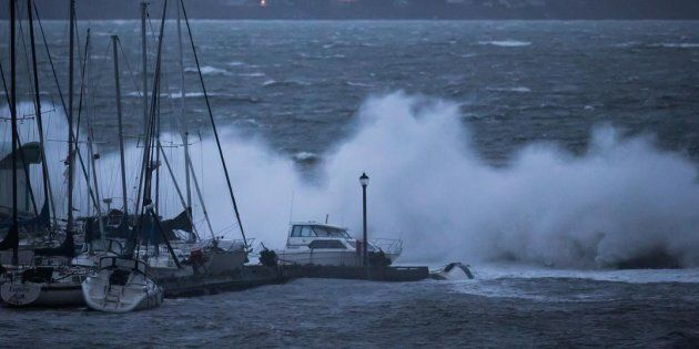 Boats are battered by waves in White Rock, B.C., on Dec. 20,