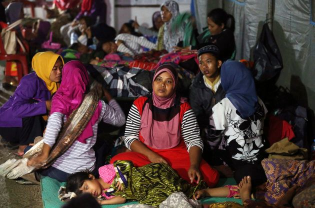 Tsunami survivors gather at temporary shelter in Tanjung Lesung, Indonesia, Sunday, Dec. 23,