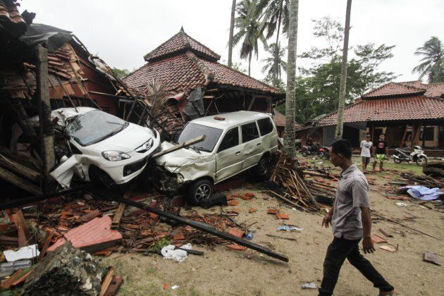 A number of buildings and vehicles are seen damaged due to being hit by a tsunami wave that hit the Pandeglang,...