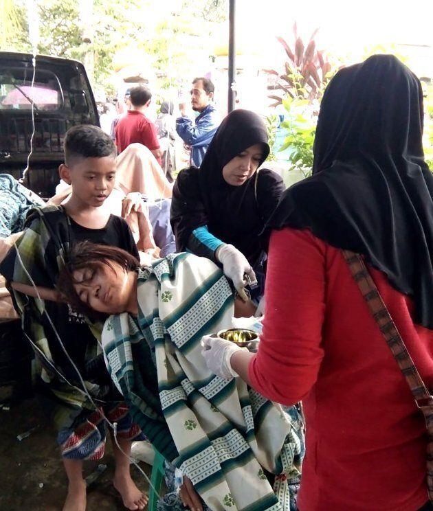 A survivor receives medical treatment at a hospital in Carita on December 23,