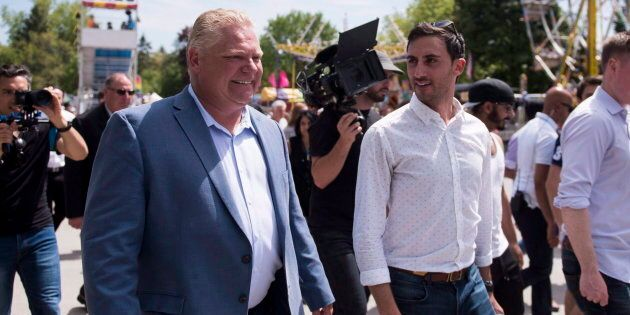 Ontario Premier Doug Ford and MPP Stephen Lecce attend the Nobleton Victoria Day Fair in Nobleton, Ont. on May 21, 2018.