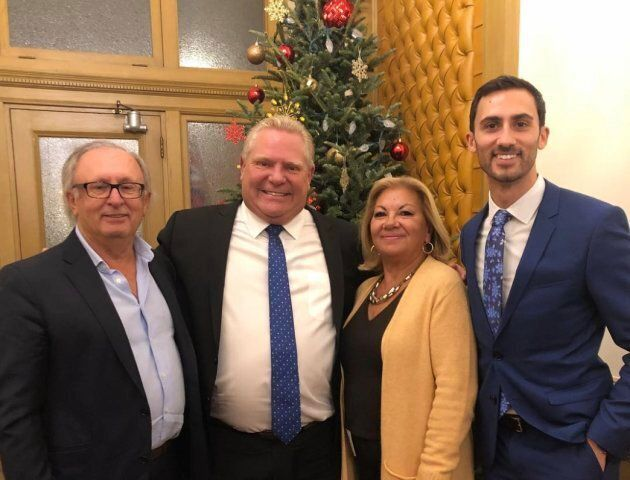 Ontario MPP Stephen Lecce and his parents pose with Premier Doug Ford at Queen's Park.