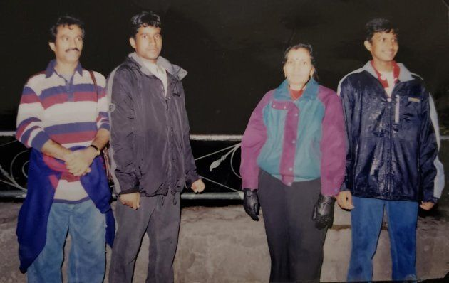 Vijay Thanigasalam, right, is seen in a 2003 photo with his parents and older brother.