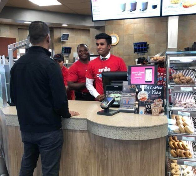 Ontario MPP Vijay Thanigasalam takes orders at a Tim Horton's. The politician worked at the coffee chain...