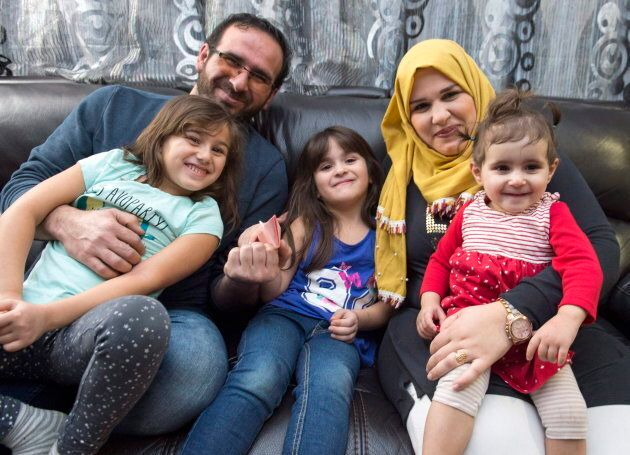 Syrian refugee family Mohammad Al Mnajer and wife Fouzia Al Hashish, far right, sit with their three...