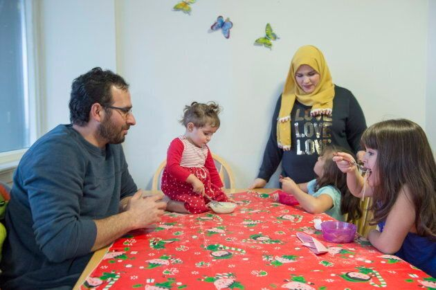 Syrian refugee family Mohammad Al Mnajer and wife Fouzia Al Hashish sit with their three daughters Judy,...
