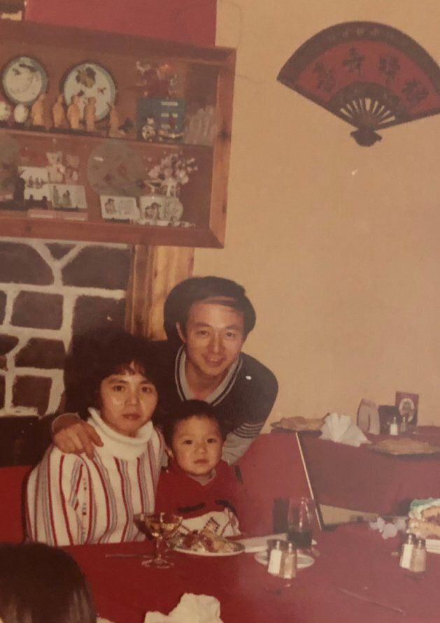 Michael Pan and his parents pose in the Montreal restaurant his father worked in around Christmas 1984....