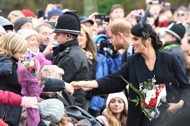 Meghan, Duchess of Sussex and Prince Harry, Duke of Sussex greet the crowds after the Royal Family's traditional Christmas service in Sandringham, Norfolk, on December 25, 2018.