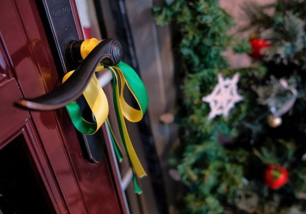 A Humboldt Broncos ribbon adorns the front door of the house of Bernadine and Toby Boulet, parents of...
