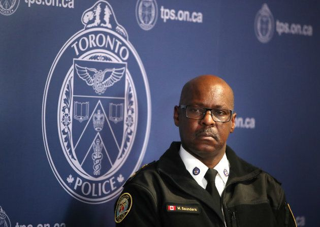 Chief Mark Saunders listens at Toronto Police Headquarters in