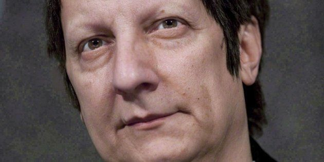 Canadian playwright, actor, film director and stage director Robert Lepage speaks to reporters at the...