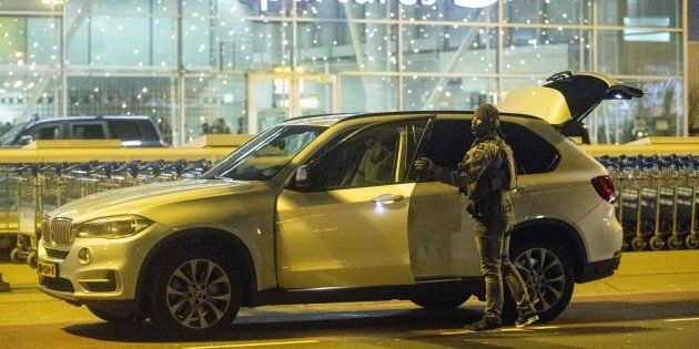 A Dutch military police officer arrives at Schiphol airport on Dec. 31, 2018, after it was temporarily...