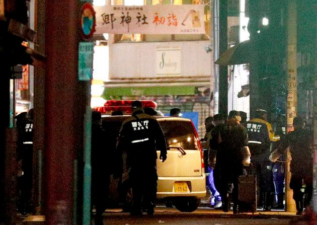 A car is inspected by police after it injured several pedestrians on Takeshita Street in Tokyo, early