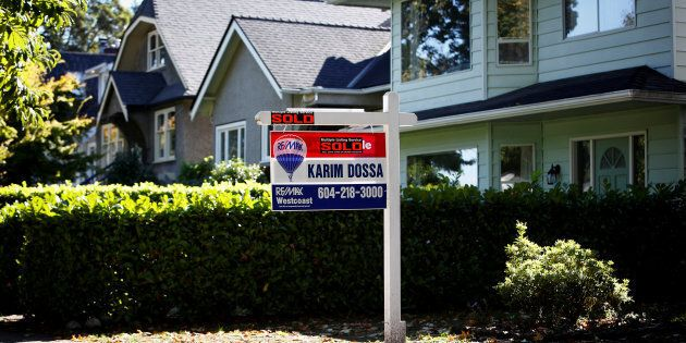 A for sale sign in front of a home in Vancouver, B.C., Sept. 22,