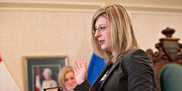 Stephanie McLean is sworn in as a new cabinet minister in Edmonton on Feb. 2,