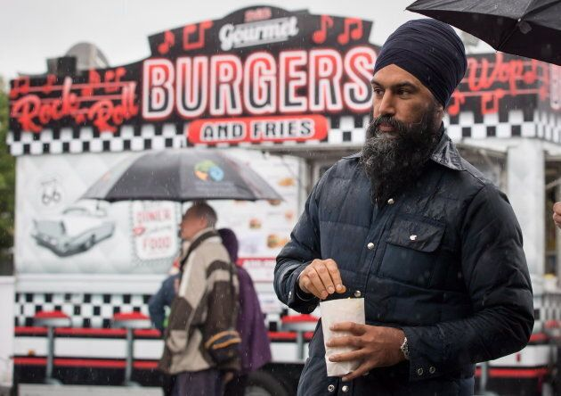 NDP Leader Jagmeet Singh eats popcorn during a visit to the Rumble on Gray Street Fair, in Burnaby, B.C....