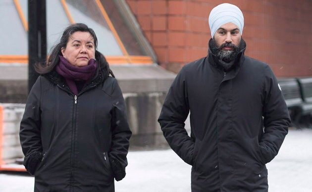 NDP Leader Jagmeet Singh and NDP candidate for the Quebec riding of Outremont Julia Sanchez cross a street during a tour of the Montreal borough on Dec. 22, 2018.