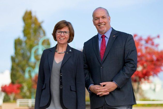 Sheila Malcolmson poses with B.C. Premier John Horgan in a photo posted to Malcomson's Facebook
