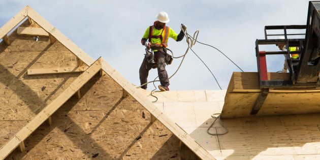 Workers build the roof of a house under construction in Brampton, Ont, Sat., May 20, 2017. The unemployment...