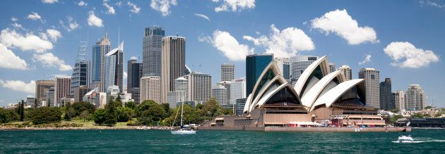 The Sydney Opera House with the Sydney, Australia, skyline in the background.