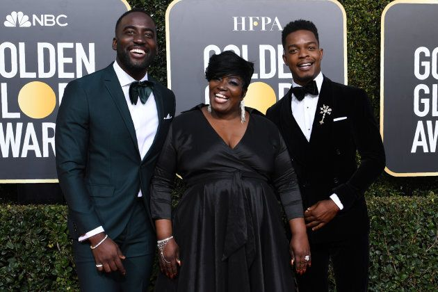 Stephan James, right, arrives with his mom and brother, Shamier Anderson (left) at the Golden Globes...