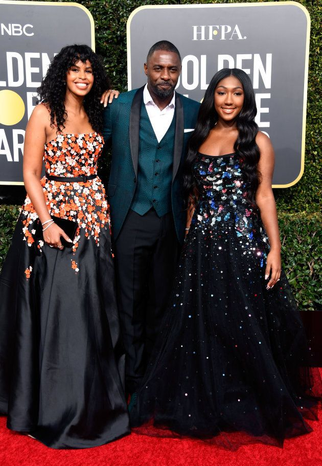 What a family portrait! Sabrina Dhowre, Idris Elba, and Isan Elba attend the 76th Annual Golden Globe Awards in LA on Jan. 6, 2019.