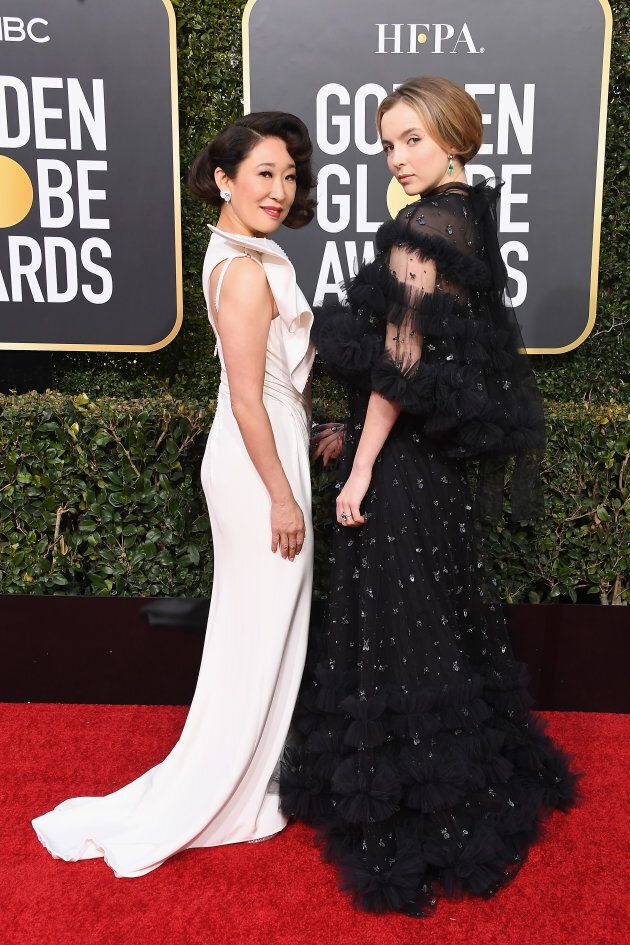 Sandra Oh and Jodie Comer on the Golden Globes red carpet.