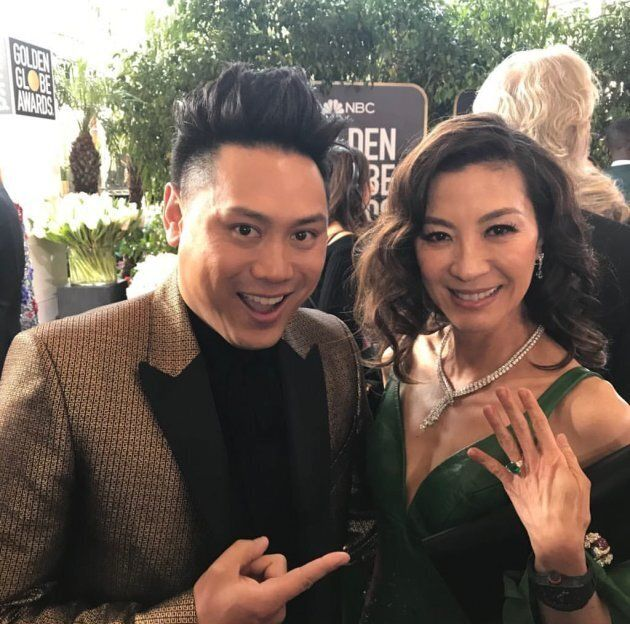 Director Jon M. Chu and Michelle Yeoh at the Golden Globes.