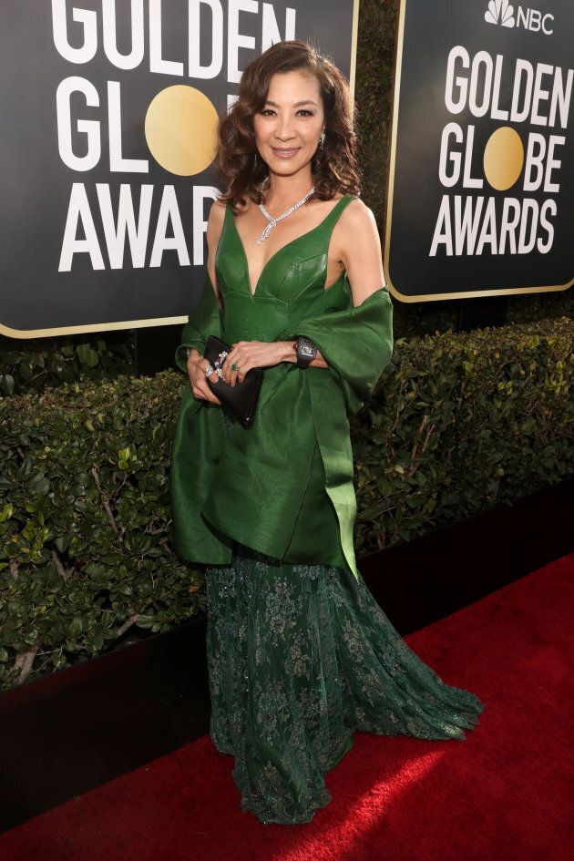 Michelle Yeoh stuns in emerald green on the Globes red carpet.