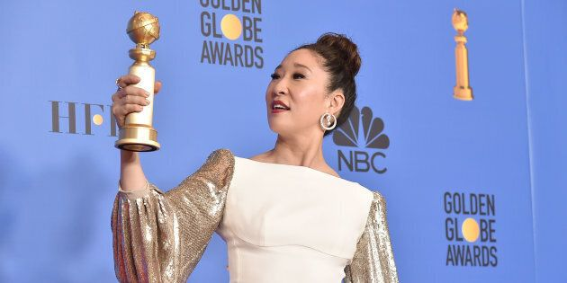 Sandra Oh admires the Golden Globe she won while hosting the 76th Annual Golden Globe Awards on January...
