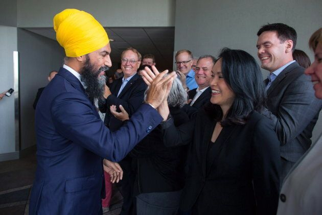 NDP Leader Jagmeet Singh, left, and MP Jenny Kwan high-five after a three-day NDP caucus national strategy session in Surrey, B.C., on Sept. 13, 2018.
