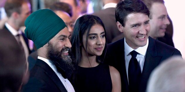 Prime Minister Justin Trudeau poses for a photo with NDP Leader Jagmeet Singh and his wife Gurkiran Singh,...