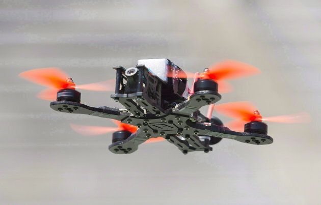 A drone hovers over the course during the Montreal drone expo on June 25,