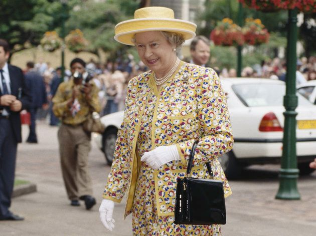 Queen Elizabeth II in Durban during a state visit to South Africa on March 25, 1995. She's wearing a...