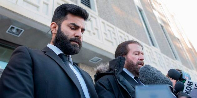 Jaskirat Singh Sidhu leaves provincial court with his lawyer Mark Brayford in Melfort, Sask. on Tuesday.