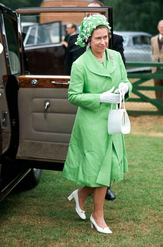 Queen Elizabeth arriving at Smiths Lawn, Windsor, after the ascot races. Her outfit is by Simone