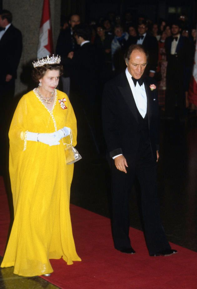 Queen Elizabeth and Canadian Prime Minister Pierre Trudeau arrive to attend a banquet on October 15,