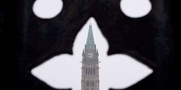 Centre Block is seen during snowy conditions in Ottawa, Dec. 11,