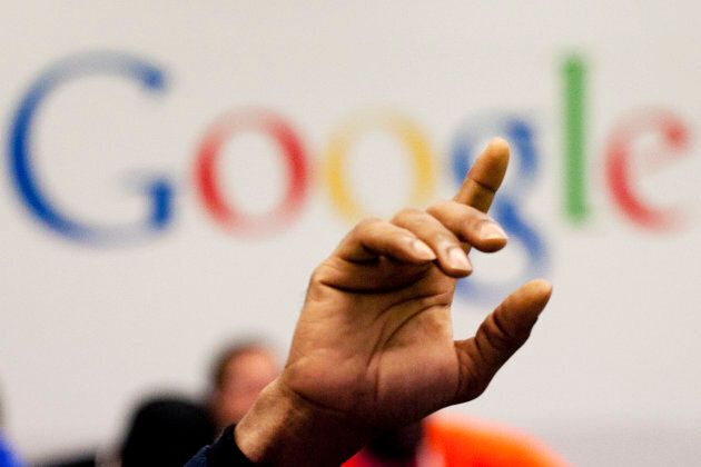 A man raises his hand during at Google offices in New York. People should have some say over the results that pop up when they conduct a search of their own name online, Europe's highest court said May 13, 2014.