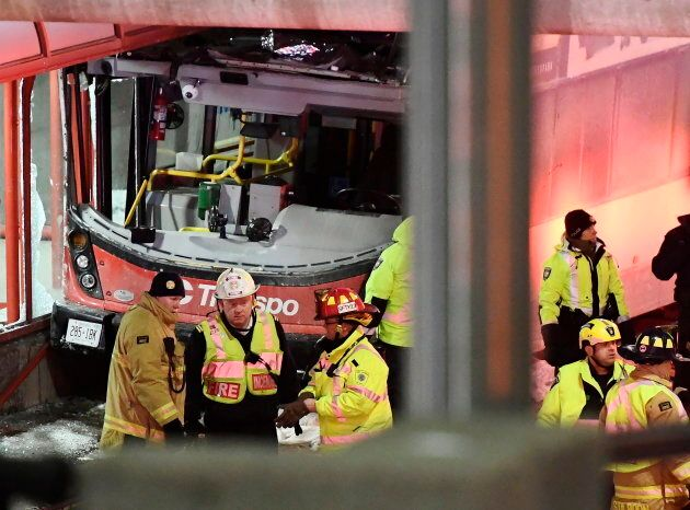Police said a double-decker bus collided with a transit shelter at a busy station west of downtown