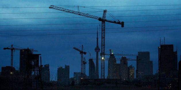 Construction cranes along the skyline in Toronto, Dec. 6, 2012. The slowdown in Canada's housing market...